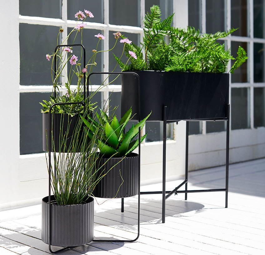 Planter box and plant pot holder on a sunny patio