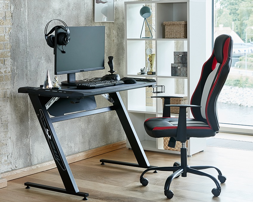 Home office with gaming computer desk and computer gaming chair
